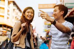 Young tourist asking for directions from local people stock photos