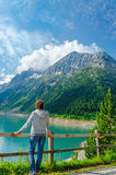 Young tourist azure mountain lake in Alps, Austria Royalty Free Stock Images