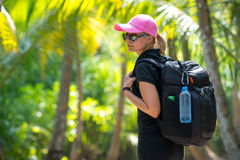 Young tourist with backpack walking in tropical jungle Stock Photography