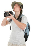 Young tourist with camera. Young man tourist with camera on white Stock Photography