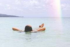 Young Tourist Caucasian Girl Swimming in the Crystal Cear Ocean. Royalty Free Stock Image