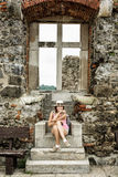 Young tourist caucasian woman posing with ancient window, Visegrad, Hungary stock image