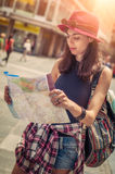 Young tourist in the city looking a map Stock Photography