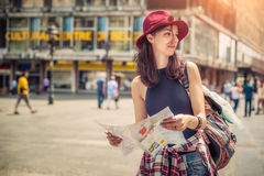 Young tourist in the city looking a map Stock Photos
