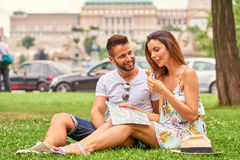 Young tourist couple in the grass Stock Image