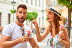 Young tourist couple with ice-cream Royalty Free Stock Images