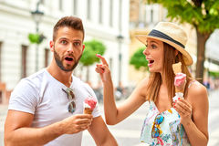 Young tourist couple with ice-cream Stock Photography