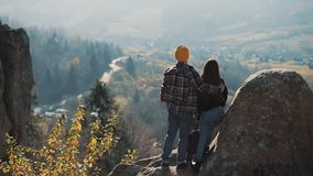Free Young Tourist Couple In Love Standing On The Rocks And Enjoy A Beautiful View. Man And Woman Visiting Famous Tourist Royalty Free Stock Photo - 136402535