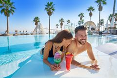 Young couple on infinity pool cocktails Royalty Free Stock Images