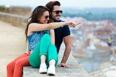 Young tourist couple looking at the views in the city. Stock Photos
