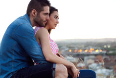 Young tourist couple looking at the views in the city. Royalty Free Stock Images