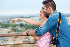 Young tourist couple looking at the views in the city. Stock Images