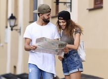 Young tourist couple with map looking for a way Stock Image