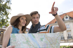Young tourist couple with map outdoors Stock Images
