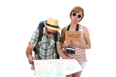 Young tourist couple reading city map looking lost and confused loosing orientation with girl carrying travel backpack Stock Photos