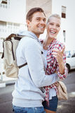 Young tourist couple smiling and pointing at something Royalty Free Stock Images