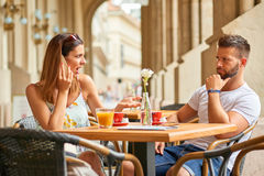Young tourist couple at a table Royalty Free Stock Photo