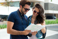 Young tourist couple in town holding a map. Stock Image