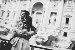 Tourist couple on travel by Trevi Fountain in Rome, Italy. Stock Photography