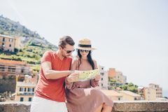Young tourist couple traveling on holidays outdoors in italian vacation. Young tourist couple traveling on vacation outdoors. Caucasian family with city map in stock photos