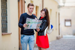 Young tourist couple traveling on holidays outdoors smiling happy. Caucasian family with city map in search of. Happy tourist couple, men and women traveling on stock photography