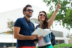 Young tourist couple use their map and pointing where they want Stock Photo