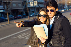 Young tourist couple use their map and pointing where they want Stock Photography