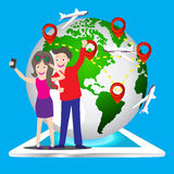 Young tourist couple using a smart phone to take a selfie picture of themselves with world map pin icon, Elements of earth map Fur. Young tourist couple using a Royalty Free Stock Image