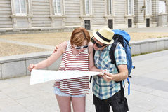 Young tourist couple visiting Madrid in Spain lost and confused loosing orientation Royalty Free Stock Photos