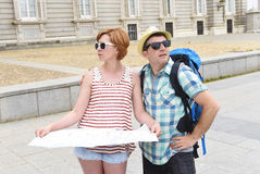 Young tourist couple visiting Madrid in Spain lost and confused loosing orientation Stock Photography