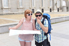 Young tourist couple visiting Madrid in Spain lost and confused loosing orientation Stock Image