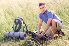 Young tourist in the field Stock Images