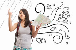 Young tourist finding a solution with city map. White background Royalty Free Stock Images