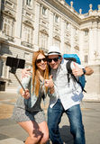 Young tourist friends couple visiting Spain in holidays students exchange taking selfie picture Stock Photos