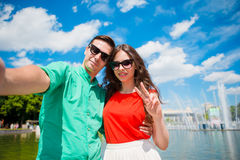 Young tourist friends traveling on holidays in Europe smiling happy. Caucasian girl and man making selfie background of. Happy tourist couple, men and women royalty free stock photo