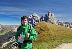 Young tourist in front of Seceda mountain in the Dolomites Royalty Free Stock Photo