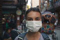 Young tourist girl with face mask Royalty Free Stock Image