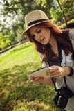 Young Tourist Girl Using Digital Tablet Royalty Free Stock Photography