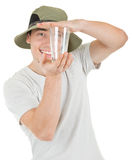 Young tourist and glass. Young man tourist on a white background Stock Images