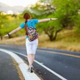 Young tourist hitchhiking along a road Stock Photography