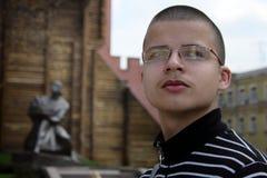 Young tourist looking around. In Kiev, Ukraine, memorial Golden Gate Stock Photography