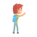 Young tourist man with backpack standing with a sign hitchhiking. Young tourist man with backpack standing with a sign hitchhiking and raised his thumb up Royalty Free Stock Photo