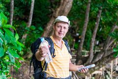 Young tourist man giving a bottle. Of water Stock Image