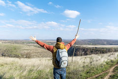 Young tourist man in the mountain with open arms - Bulgaria. Hiker man  in a high  mountain.Beautiful landscape from Bulgaria Royalty Free Stock Image