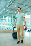Young tourist man with passport and boarding pass at airport ready to tfly. Closeup of man holding passports and boarding pass at airport Royalty Free Stock Photography