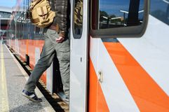 Young tourist man on railway station near train doors Royalty Free Stock Photos