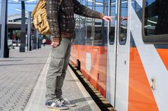 Young tourist man on railway station near train doors Royalty Free Stock Photography
