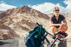 Young tourist man travel with bike in Himalaya montain Royalty Free Stock Photography