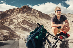 Young tourist man travel with bike in Himalaya montain Royalty Free Stock Images