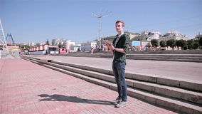 Young tourist man using map on his tablet walking in the city. stock video footage